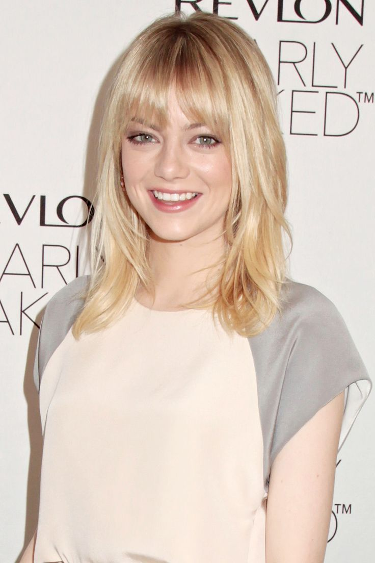 Long straight hair with bangs - Emma Stone hairstyles
