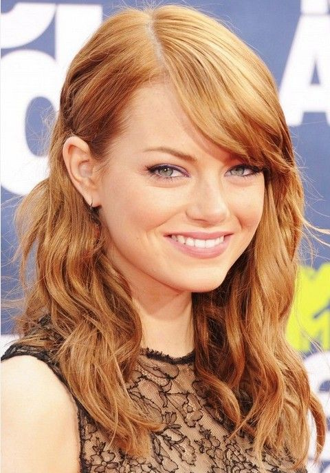 Parted parted curly hair - Emma Stone hairstyles