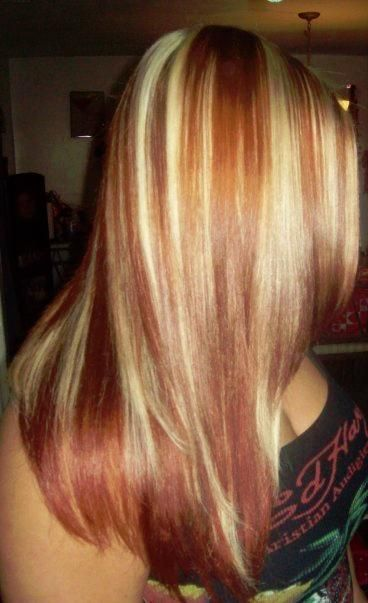 Straight blonde hair with red highlights