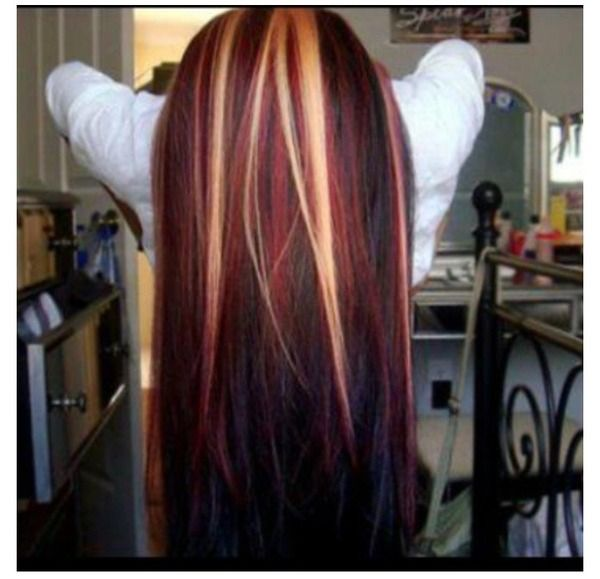 Long blonde hair with red highlights