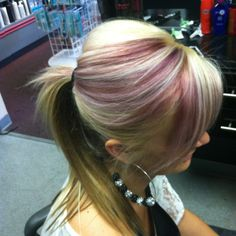 Blonde ponytail with red highlights