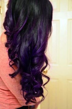Black wavy hairstyle with purple highlights