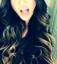 Black wavy hair with blonde highlights