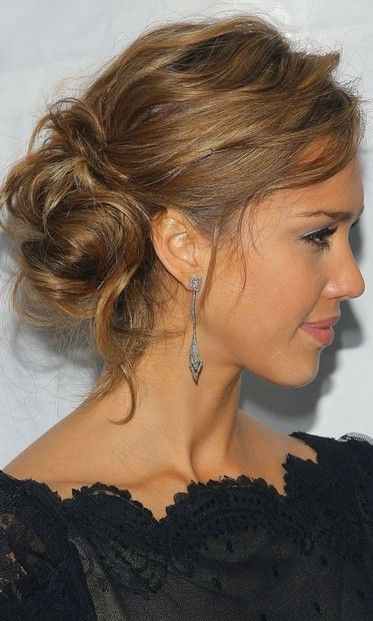 Messy bun hairstyle swept to the side