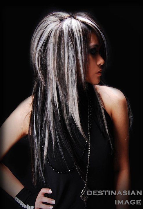 Layered straight black hair with blonde highlights