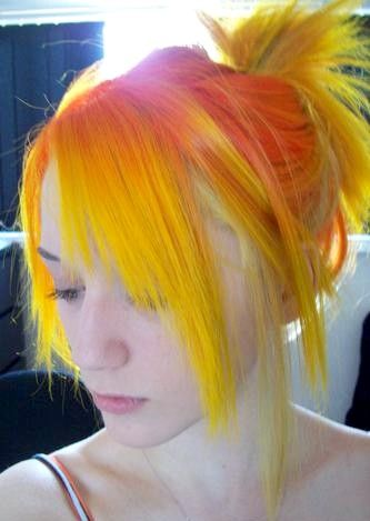 Yellow and orange hairstyle with bangs