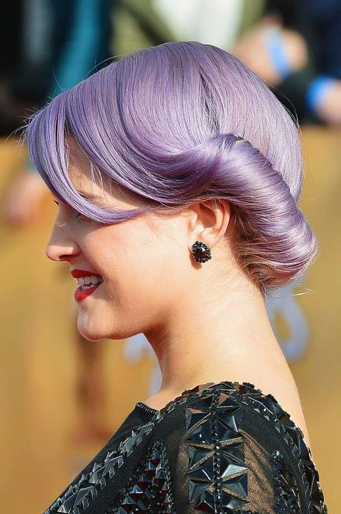 Purple colored low bun for Kelly Osbourne hairstyles