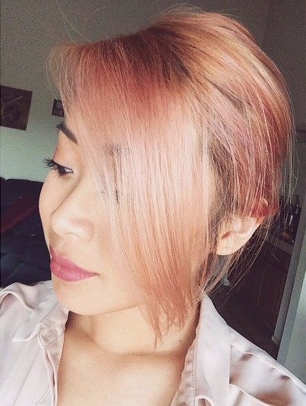 Chic rose gold hairstyle with long bangs
