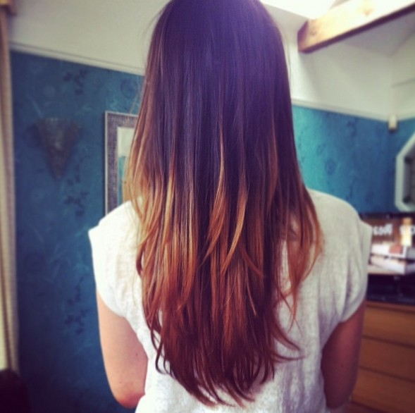 Rear view of long dark to blonde straight ombre hair for girls
