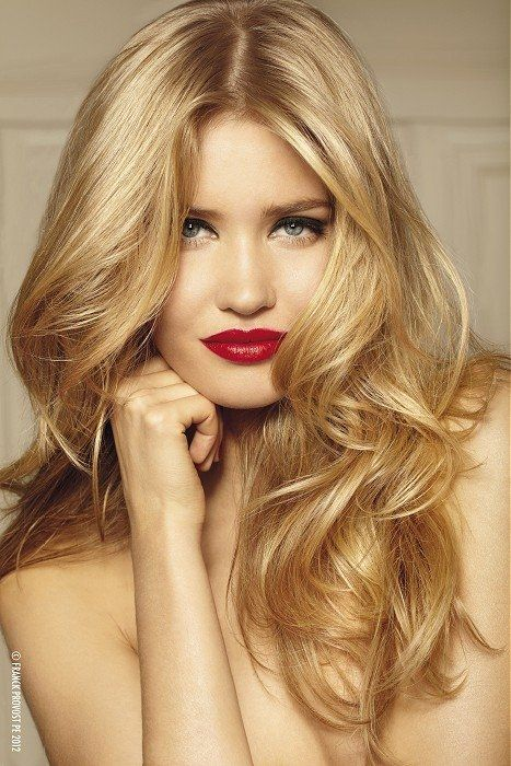 Golden curls and red lips