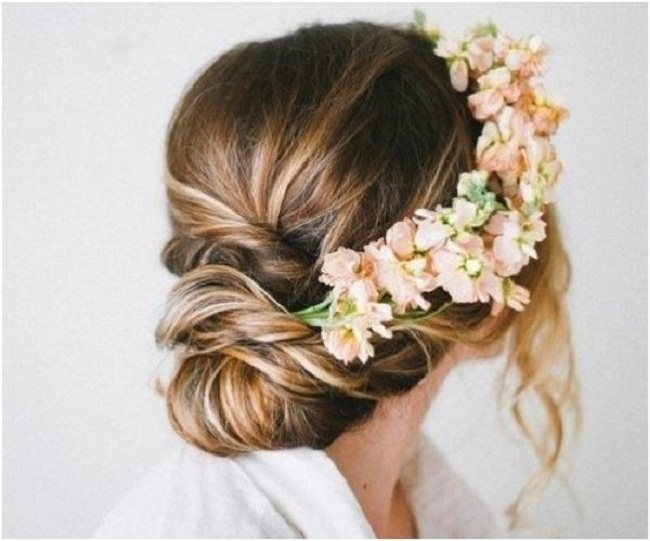 Low bun hairstyle with accessories