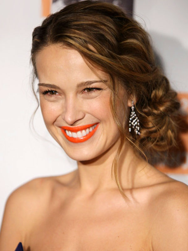 Braided hairstyle with a low bun