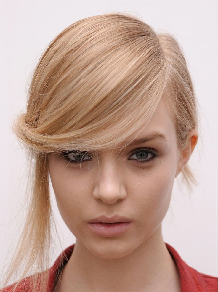 Interesting side-swept hairstyle with fringes