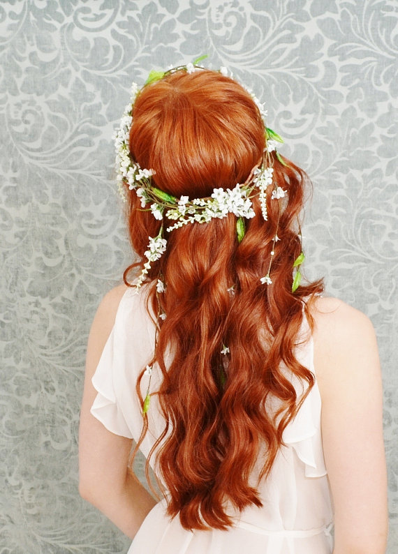 Long wavy flower bridal hairstyle over