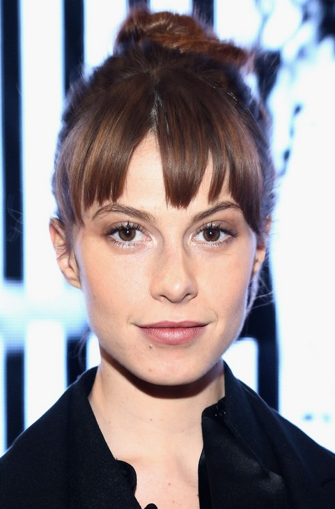 Elettra Wiedemann updo hair bun with swept bangs