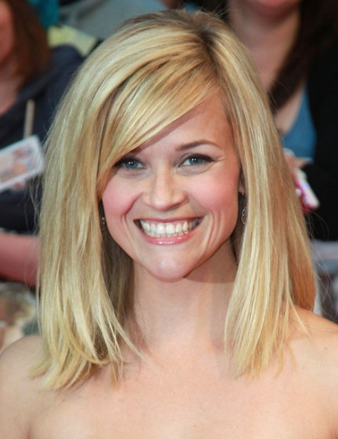 Reese Witherspoon Medium Length Hairstyle: Blonde Hair with Swept Bangs