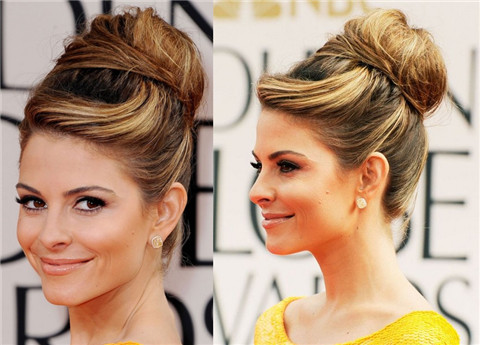 Maria Menouno's hairstyles: voluminous updo