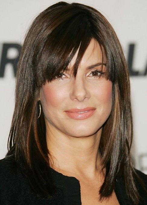 Sandra Bullock medium length hairstyle: straight haircut with side-swept bangs