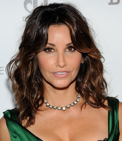 Gina Gershon Hairstyles: Middle Part Curls