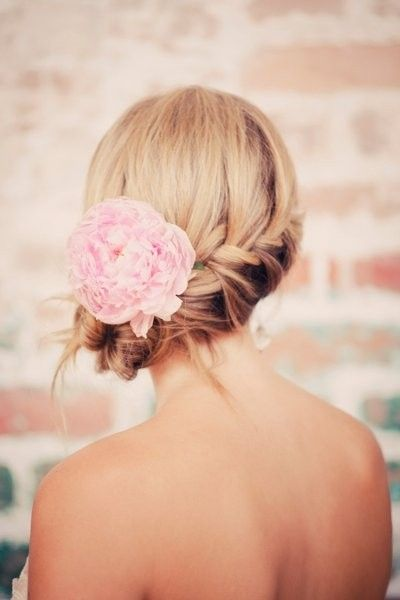 Bridesmaid hairstyle with flower for long hair