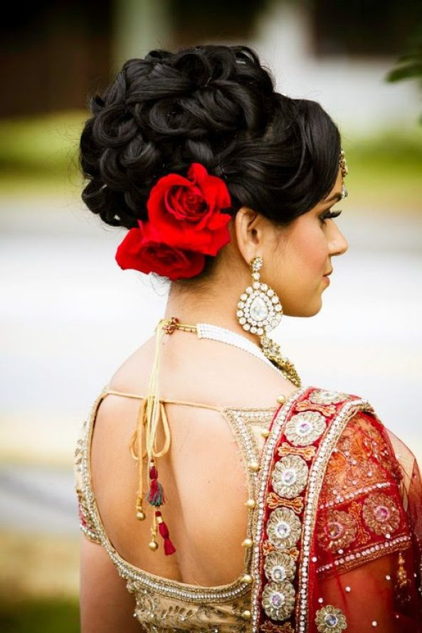 Glamorous Indian wedding hairstyle with flower