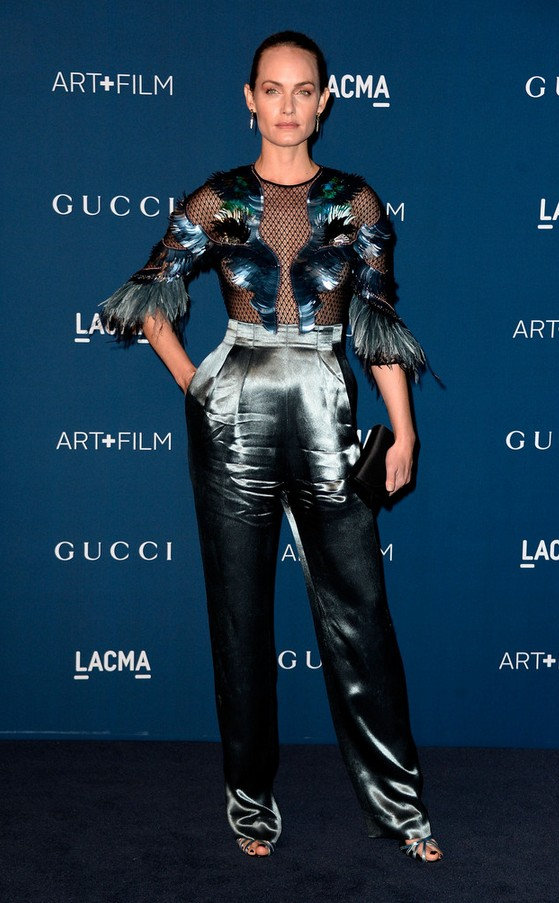 Blue Gucci jumpsuit in Amber Valletta with mesh and feather bodice