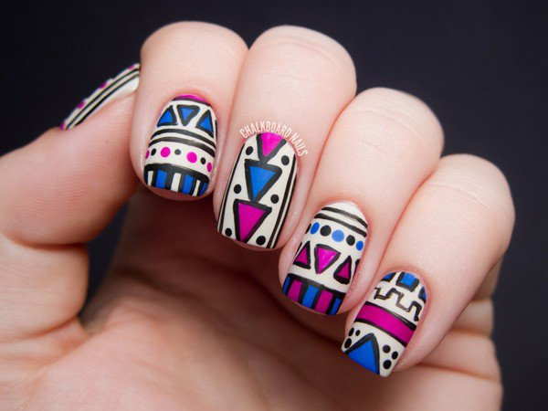 White and blue tribal nail design
