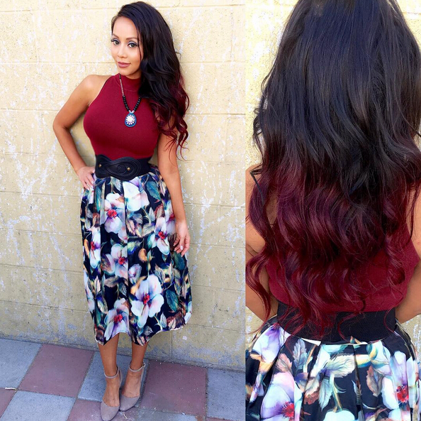 Long wavy hairstyle with red highlights