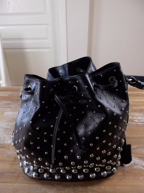 ALEXANDER MCQUEEN black studded leather bucket bag with skull .