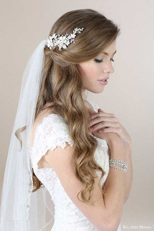 Beautiful low updo hairstyle idea with fancy stone head piece hair .