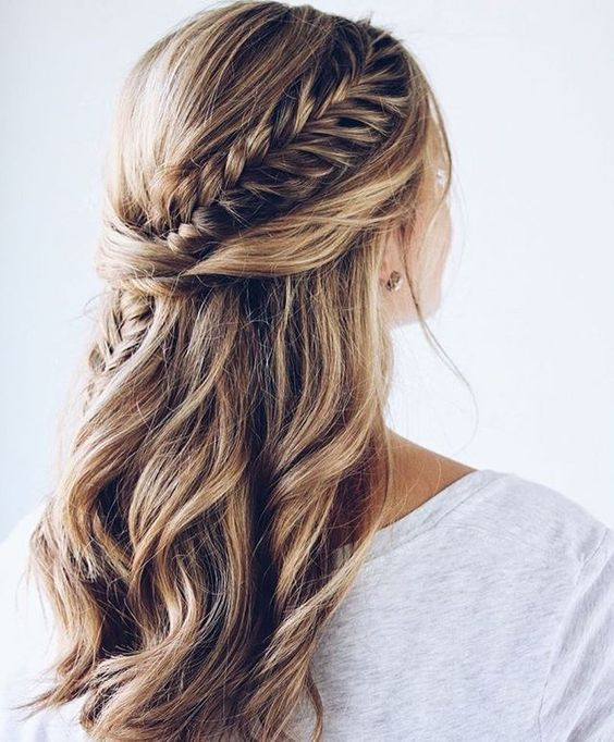 a chic half updo with waves, twists and a fishtail braid going .