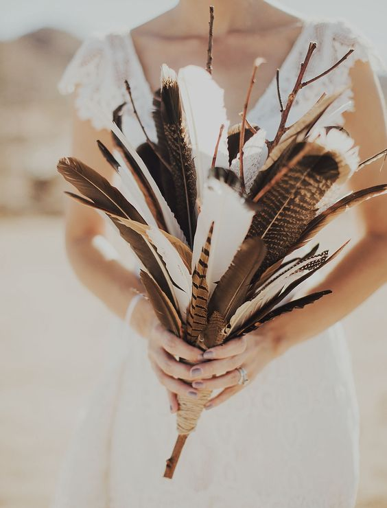 Picture Of a feather and branch wedding bouquet is a creative boho .