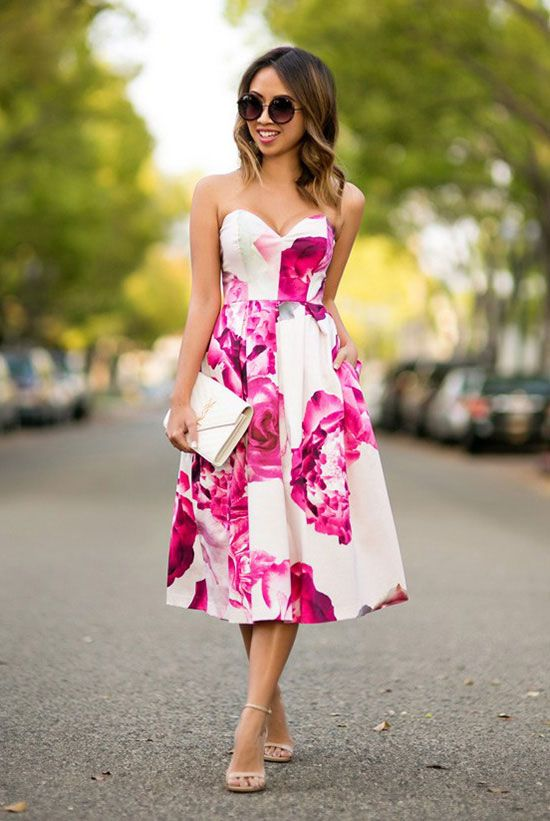 Picture Of a strapless pink floral print midi dress, nude shoes .