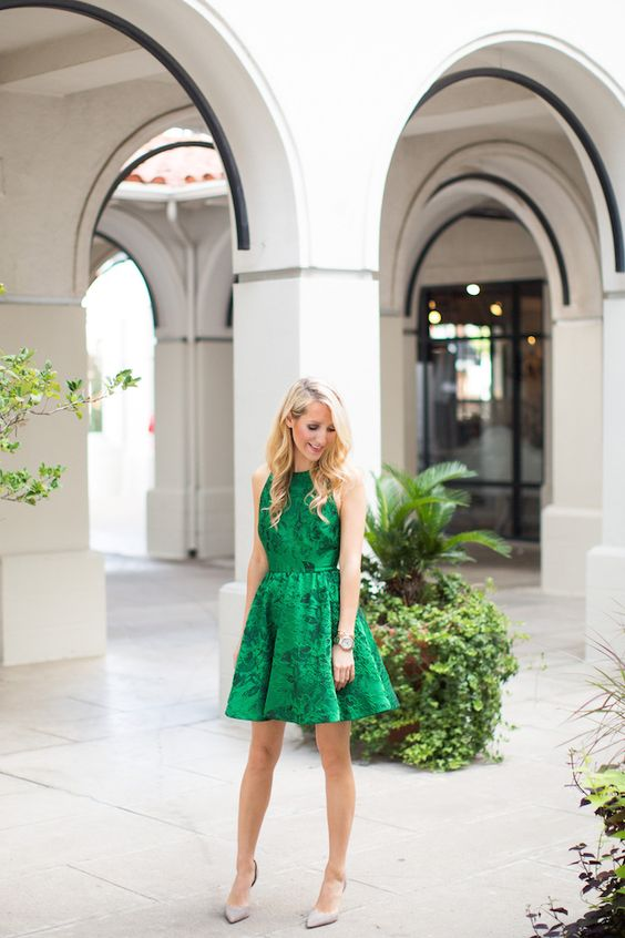 Picture Of sleeveless emerald green floral print dress with a .
