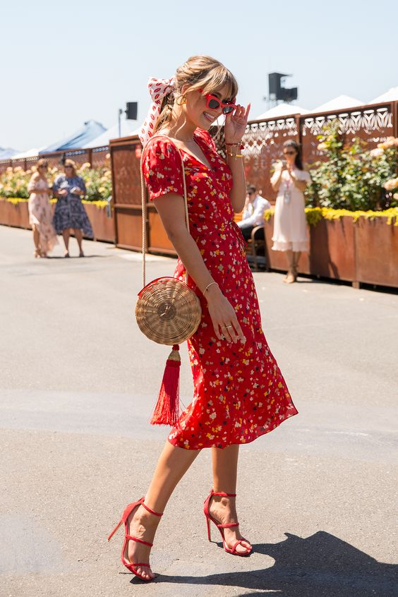 Picture Of a hot red floral print midi dress with short sleeves .