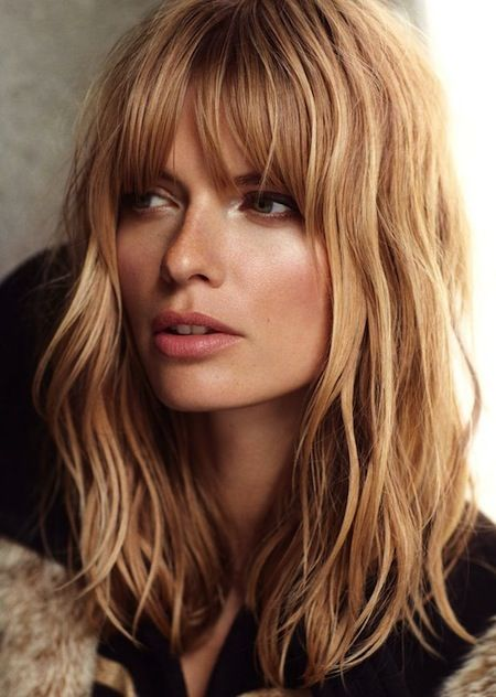 Light beachy waves and full bangs. Bangs with shoulder length hair .