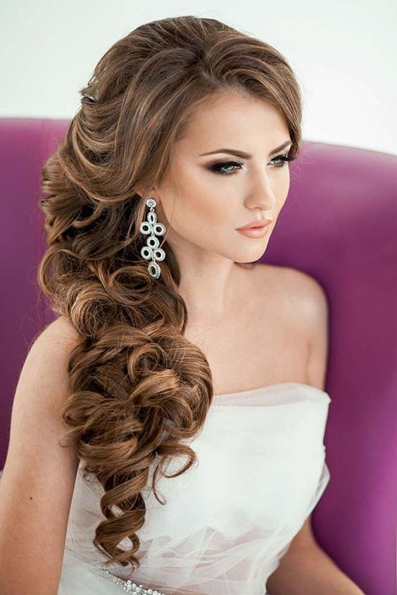 Picture Of elegant side swept curls with side ban