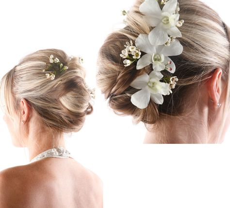 love the flowers to spice up a simple up do. | Wedding hairstyles .