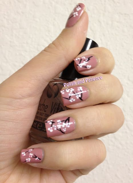 Oh my gosh this is the cutest one yet. Cherry Blossom nail art .