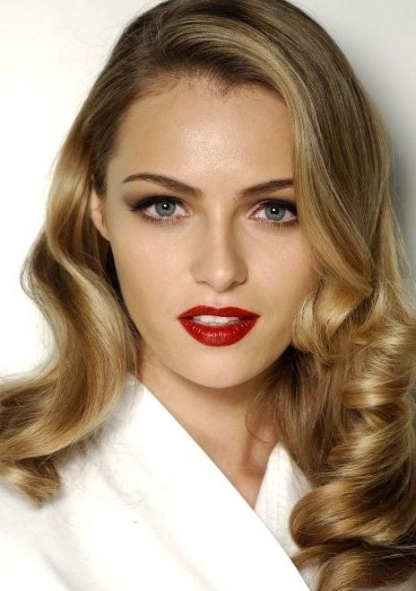 Holiday makeup red lip bronze eye : Get this complete look .