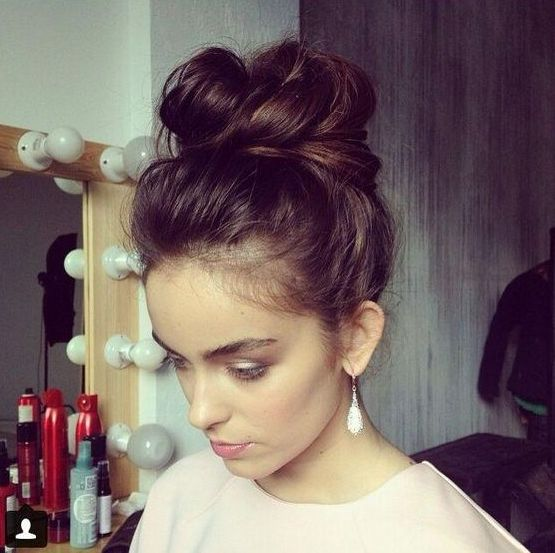 Picture Of messy top knot hairsty