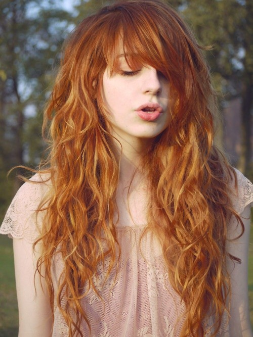 Eye-catching Tousled Orange Waves - Long Wavy Hairstyle with Bangs .