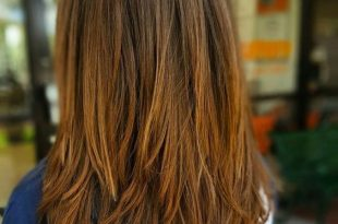 Picture Of a chic medium layered haircut with ombre detailing for .