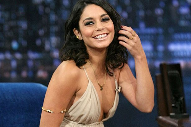 Vanessa Hudgens shows off her cleavage in a dangerously low cut .