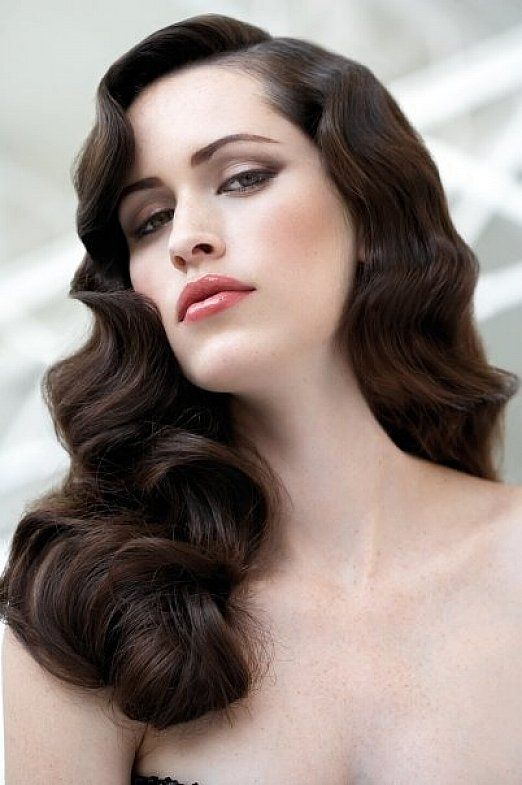 Vintage big curly hairstyles with side bangs for long hair .