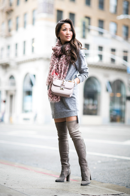 Wendy Nguyen is wearing a pale grey sweater dress from Glamorous .