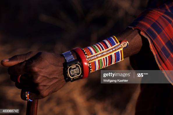 Kenya, Amboseli, Masai Man, Close-up Of Arm Jewelery With Modern .