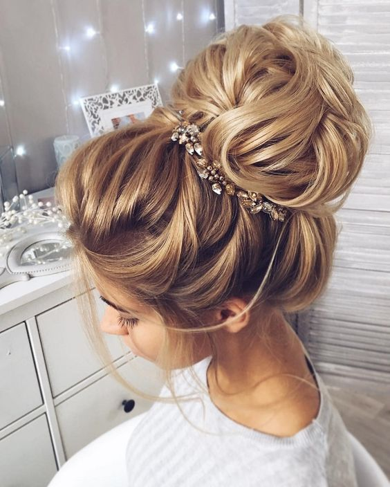 This beautiful high bun wedding hairstyle perfect for any wedding .