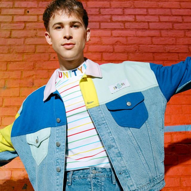 The jean jacket colors block Tommy Dorfman on one of its post .