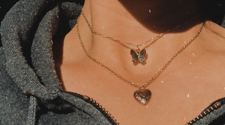 Cute layered necklace with a butterfly and a heart very simple and .